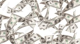 16215226-flying-money-american-dollars-background-stock-photo